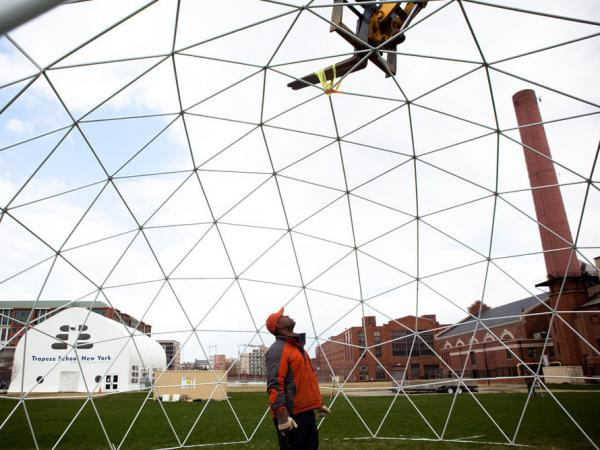 Bryon Brown's Sensorium is a unique, 12-course dinner party that's part circus, part play. It was held in a three-story high geodesic dome, shown here under construction, in Washington, D.C. this spring.