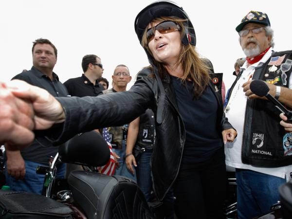 Former Alaska Gov. and GOP vice presidential nominee Sarah Palin greets some of the thousands of motorcycle enthusiasts and military veterans participating in the Rolling Thunder rally on Sunday.