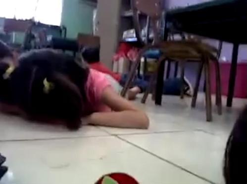 The kindergarten kids got down on the floor as the shots were fired. Their teacher kept them singing.