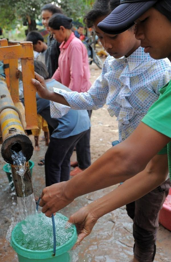 Cambodian villagers get water from a truck at a camp in Preah Vihear province, some 300 miles northwest of Phnom Penh. Though 92 percent of households in Phnom Penh have clean running water, many in rural Cambodia rely on trucks or water purification tablets.
