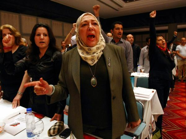 Syrian opposition activists chant in Antalya, Turkey during the opening session of a three-day meeting to discuss democratic change and voice support for the revolt against President Assad's regime.