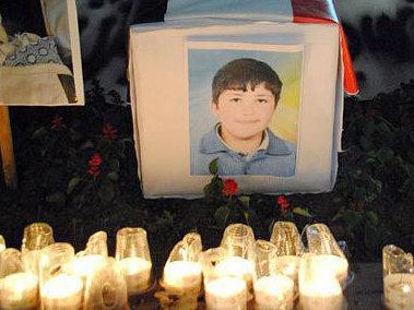 In a photo from a Facebook page in memory of Hamza al-Khateeb, an image of 13-year-old Hamza is surrounded by candlelight.