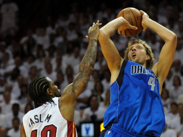 Dirk Nowitzki (R) of the Dallas Mavericks shoots over Udonis Haslem (L) of the Miami Heat during Game 2 of the NBA Finals on Thursday (June 2, 2011) in Miami. Nowitzki hit the decisive layup with 3.6 seconds remaining as the Mavericks rallied to beat the Heat 95-93.