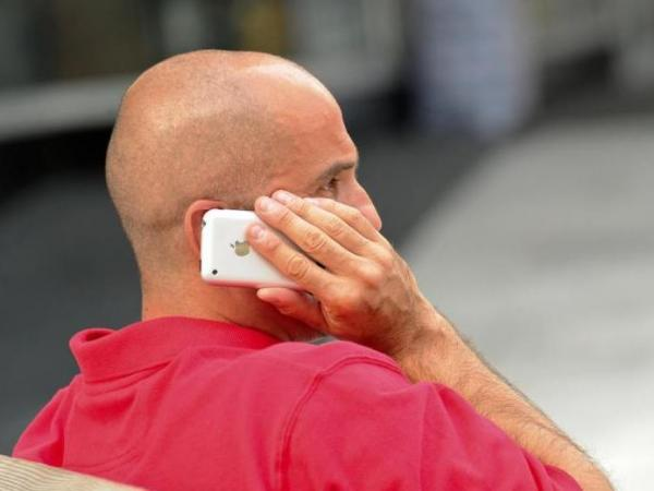 A Washington man talking on his cellphone may be taking a health risk, according to an analysis from the World Health Organization that finds a possible risk of cancer from exposure to the devices.