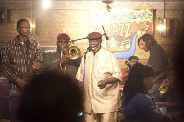 "Al ""Carnival Time"" Johnson (center, singing) sits in with Antoine Batiste and the Soul Apostles on <em>Treme</em>. Batiste, the trombonist, is played by Wendell Pierce."