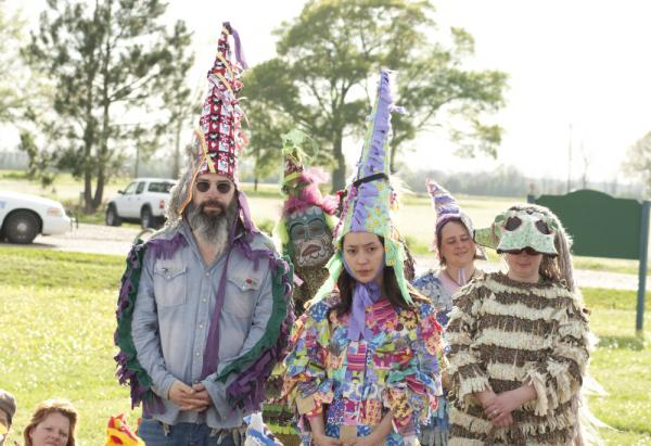 Harley (Steve Earle, left) and Annie (Lucia Micarelli, center) join the traditional Faiquetaigue courir de Mardi Gras on <em>Treme</em>.
