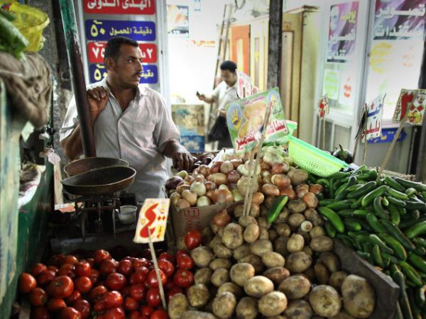 A vegetable seller waits for customers at Ataba market in Cairo. Tourism has dropped since the revolution that removed President Hosni Mubarak from office, and Egypt's economy is sagging.
