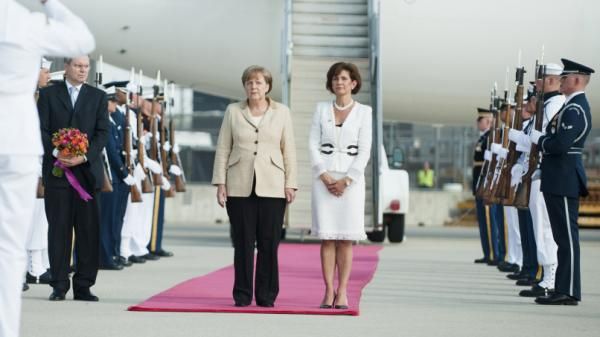 German Chancellor Angela Merkel is greeted by White House Chief of Protocol Capricia Marshall, right, after her arrival in Washington, D.C., on June 6.