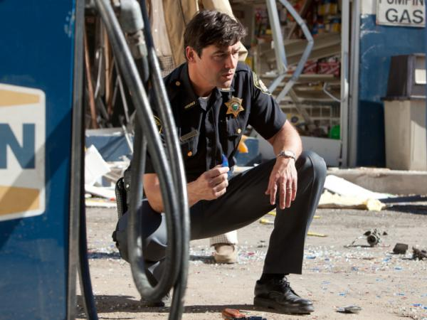<em>Friday Night Lights</em> star Kyle Chandler plays lawman Jackson Lamb, whose kid stumbles onto a cover-up involving the Air Force — and a top-secret cargo that's gotten out of control.