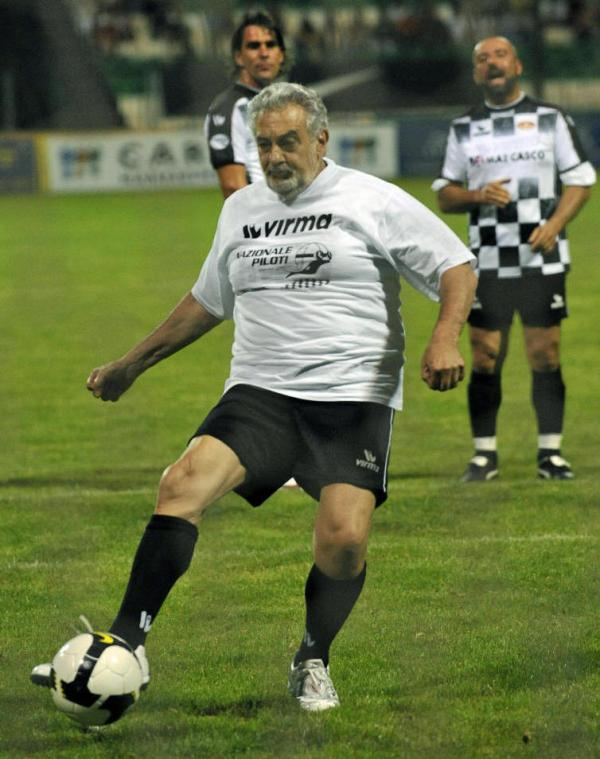 Placido Domingo kicks a penalty shot in a July 2008 charity soccer match held in Hungary.