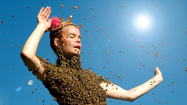 <strong>'Sun' Dance:</strong> Beekeeper and healer Sara Mapelli performs with 12,000 bees in a scene from <em>Queen of the Sun</em>. The film is a hymn to nature's under-appreciated pollinators — whose existence has come under threat.