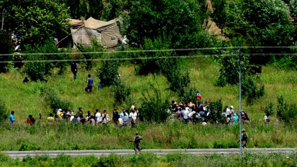 Syrian refugees waited to cross the border into Turkey near the Turkish city of Hatay on Wednesday. Turkish authorities confirmed that 120 Syrians had crossed the border late Tuesday.