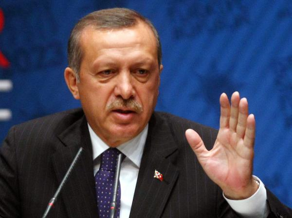 "Turkish Prime Minister Recep Tayyip Erdogan said Wednesday that Turkey will not ""close its doors"" to people fleeing the unrest in neighboring Syria."