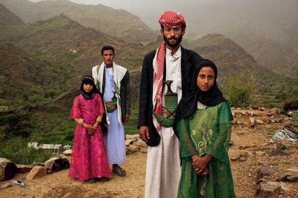 """Whenever I saw him, I hid. I hated to see him,"" Tahani (in pink) recalls of the early days of her marriage to Majed, when she was 6 and he was 25. The young wife posed for this portrait with former classmate Ghada, also a child bride, outside their mountain home in Hajjah."