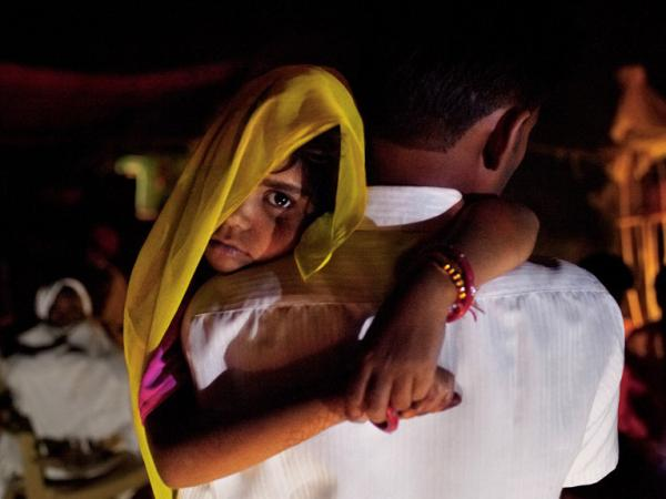 Long after midnight, 5-year-old Rajani is roused from sleep and carried by her uncle to her wedding. Child marriage is illegal in India, so ceremonies are often held in the wee hours of morning. It becomes a secret the whole village keeps, explained one farmer.