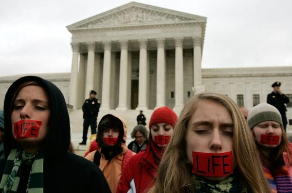 Members of Bound 4 Life, a group opposed to abortion rights, pray in front of the U.S. Supreme Court in early 2006.