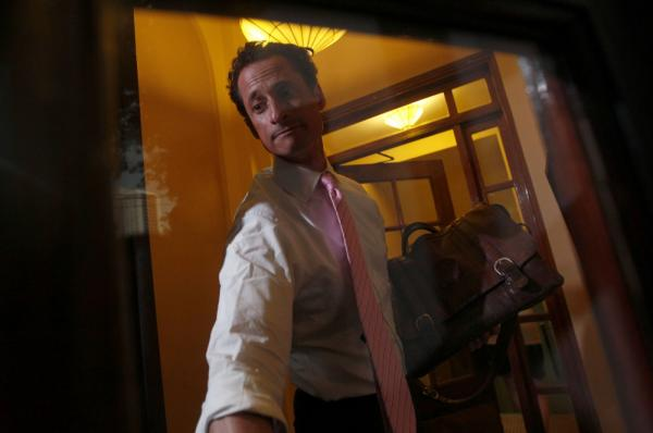 Rep. Anthony Weiner, D-N.Y., closes the front door of his building when arriving home in New York, June 9, 2011.