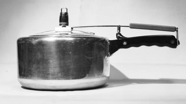 Water normally boils at 212  degrees Fahrenheit — and doesn't get hotter. But under pressure, it boils at 242 F. In a pressure cooker, food cooks at a higher temperature, which speeds up the cooking process. Above, a 1948 pressure cooker.