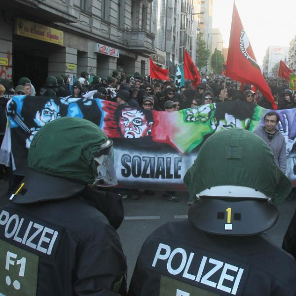 Left-wing demonstrators confront riot police during a May Day march.