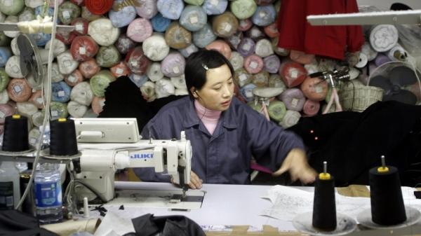 A Chinese employee works in a textile firm in the Macrolotto area in Prato, the biggest textile district in Europe, in 2005. The town has become home to the largest concentration of Chinese residents in Europe — many of whom are not legal.
