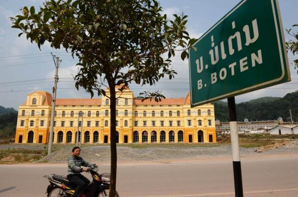 The town of Boten in northern Laos along the Chinese border will be the first stop for high-speed trains outside China. Local government officials hope the train will help boost the local economy by bringing tourists who will stay at hotels like this one, currently under construction.
