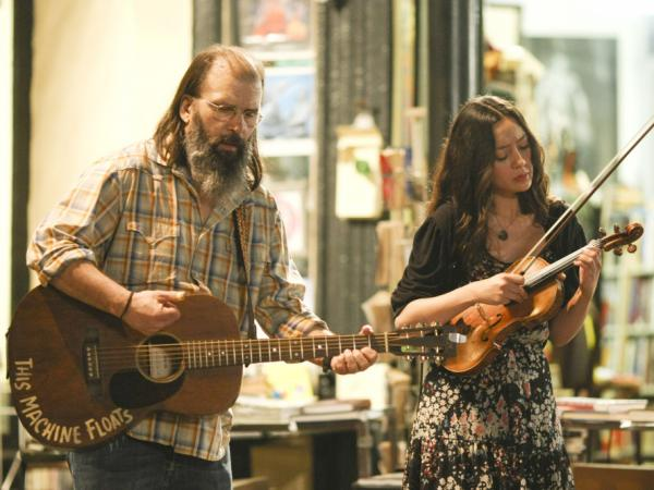 Harley (Steve Earle, left) and Annie (Lucia Micarelli) busk in the French Quarter in <em>Treme</em>.