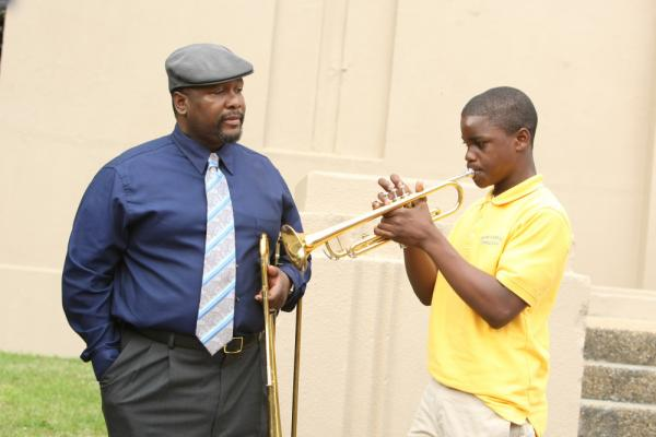 Antoine Batiste (Wendell Pierce) instructs his young band student in <em>Treme</em>, played by Jaron Williams.