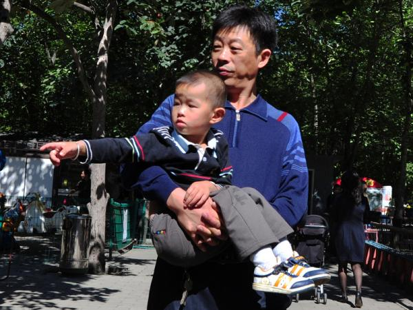 A man carries his son at a Beijing park. China's one-child policy has been blamed for the current gender-imbalance in China, where sex-specific abortions remain common.