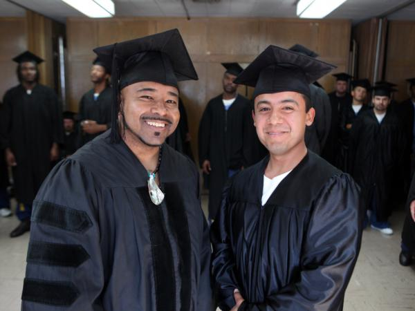 Phillip Senegal (left) and valedictorian Felix Lucero earned associate of arts degrees in 2009 at a ceremony in San Quentin state prison, where they are inmates. The college program is an extension of Patten University in Oakland, Calif.