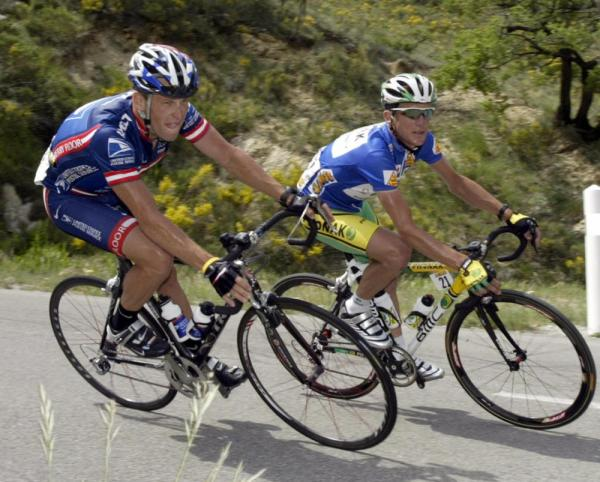 "Lance Armstrong (L) rides close to compatriot Tyler Hamilton during the fifth stage of the ""56th Criterium du Dauphine Libere"" in June of 2004."