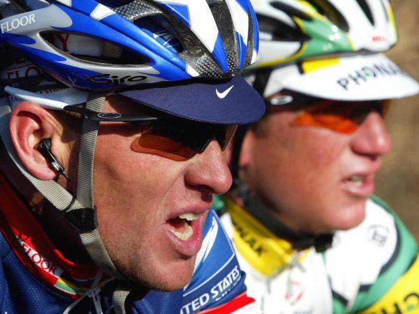 U.S. Postal Service cycling team leader Lance Armstrong (L) of the United States and Tyler Hamilton ride during the second stage of the 73nd Criterium International cycling race.