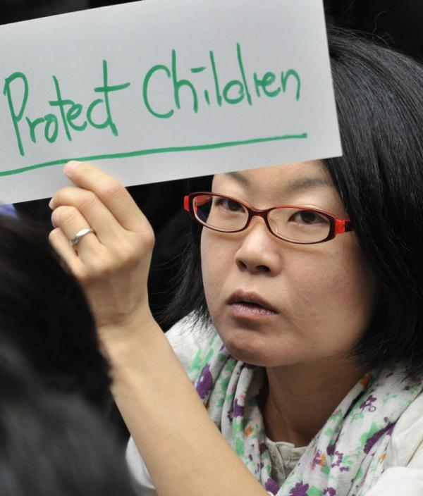 May 23, 2011: A woman outside the Education Ministry in Tokyo expresses her opinion. Many in Japan say the government is not doing enough to protect children from radiation that's leaking from the Fukushima Dai-Ichi nuclear power plant that was crippled in the March 11 earthquake and tsunami.