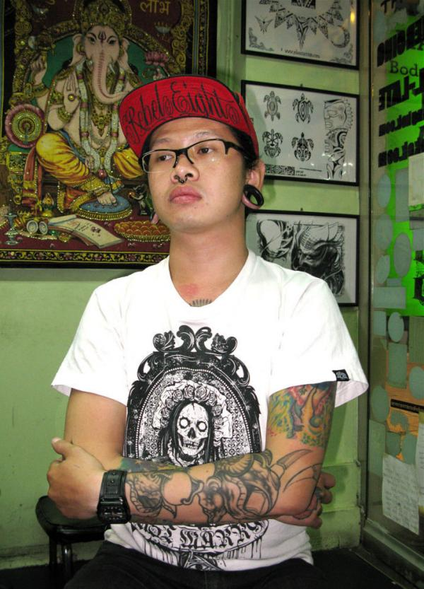 Pongsuk Tammaget, a tattoo artist in Bangkok's Khao San Road neighborhood, says he and other Thai Buddhists are offended by foreigners who get Buddhist images tattooed below the waist.