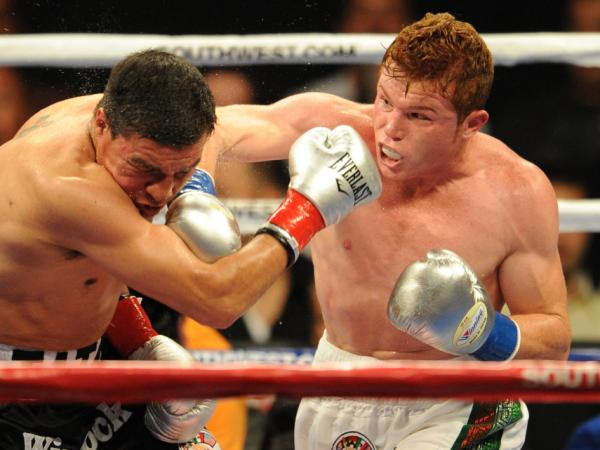 Saul Alvarez of Mexico (right) lands a punch before knocking out opponent Carlos Baldomir of Argentina at a fight in 2010. In March, Alvarez became the WBC super welterweight champion, and will defend the title Saturday in his hometown of Guadalajara.