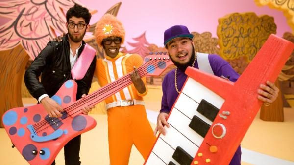 The dance-rock duo Chromeo goofs around on the set of <em>Yo Gabba Gabba!</em> with host DJ Lance Rock (center).