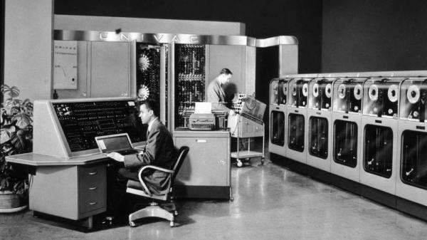 Two men operate the enormous UNIVAC (UNIVersal Automatic Computer) in 1960.