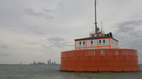 "Investors hope to someday build lake-based turbines on Lake Erie. Right now the only structure on the water outside of Cleveland, Ohio is a century-old, iron-clad water intake ""crib"" which is topped with instruments that monitor wind speeds and other meteorological data."
