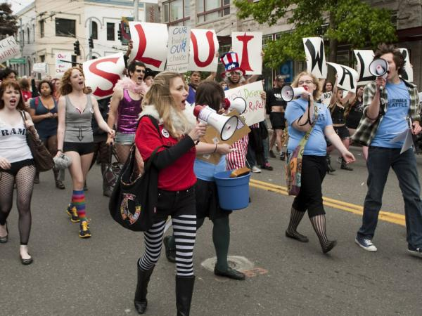 "Protesters march at the SlutWalk in Seattle on June 19. SlutWalks began in April when a Toronto police officer suggested women ""avoid dressing like sluts"" in order to not be victimized."