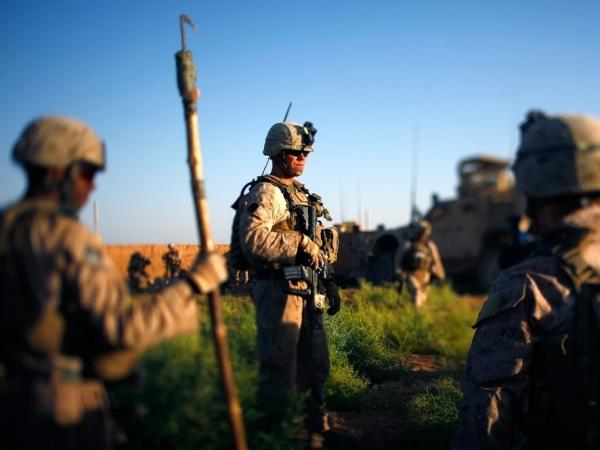 Marines pause during an operation earlier this month in Marjah, Helmand Province, Afghanistan.
