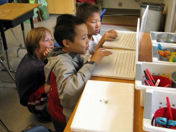 Fifth graders (from left) Reese Toomre, Lucas Nguyn and Michael An race through the Khan  Academy's Trigonometry Challenge. The program allows more advanced students to  race ahead, while other students can proceed at their own pace.