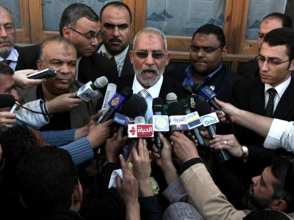Mohammed Badie, the head of Egypt's Muslim Brotherhood, speaks to the press in Cairo on March 19. Democracy activists argue that the timetable for elections is too rapid and will give the advantage to the Muslim Brotherhood and  elements of Mubarak's old party.