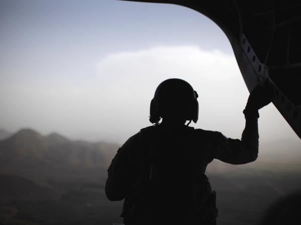 A U.S. Army crewman sits at the rear of a CH-47 Chinook helicopter accompanying the Blackhawk of Defense Secretary Robert Gates (not pictured) between Forward Operating Bases in over eastern Afghanistan, Monday, June 6, 2011. President Barack Obama is expected to make an announcement about the next phase of military operations in Afghanistan later today.