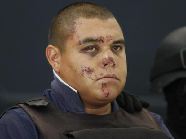 "Jaime Francisco Leyva Merlos, aka ""El Bebe"" at the federal police headquarters in Mexico City on Wednesday.  According to the federal police, Leyva Merlos is a member of a group known as 'Los Caballeros Templarios.' He and seven other alleged members were arrested by federal police on June 21."