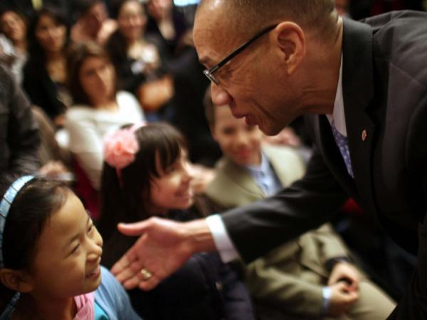 Deputy mayor for education Dennis Walcott speaks with school children after being introduced by New York Mayor Michael Bloomberg as New York City's new Schools Chancellor following the departure of the controversial Cathleen Black on April 7 in New York City.