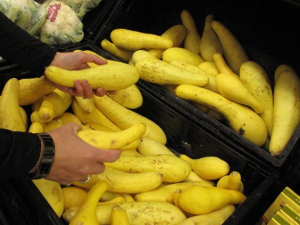 Walmart store manager Emily Bowman notices some yellow squash with brown spots — and takes about 40 off the shelves and puts them on a donation cart.