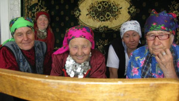 "The ""Buranovo Babushkas"" watch video, for the first time, of two of their members appearing on Russia's <em>Who Wants to Be a Millionaire?</em> program."