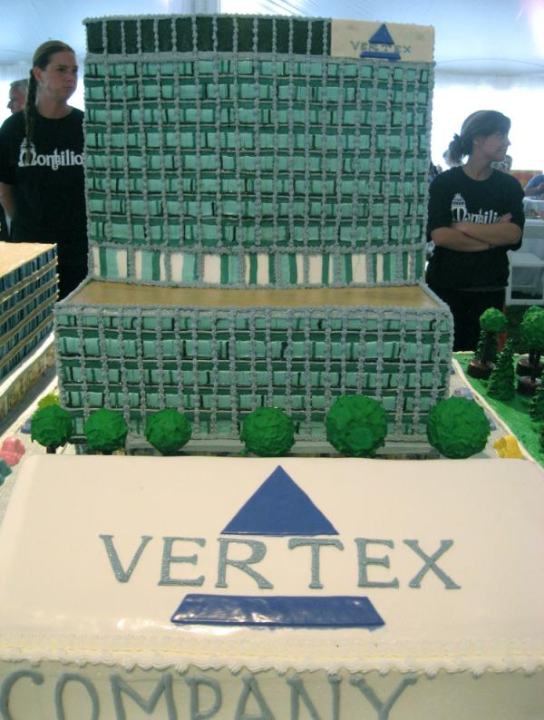 The groundbreaking fanfare included a cake model of Vertex's new corporate headquarters.