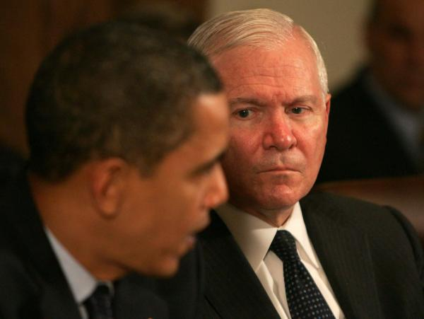Secretary Gates listens as President Barack Obama speaks at a cabinet meeting at the White House. Gates began serving as defense secretary under the Bush administration, and is the first to continue in a different party.