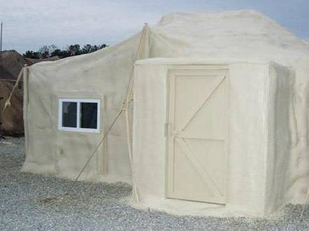 A U.S. military tent after treatment with polyurethane foam.  A 2006 test of the foam cut energy use by 92 percent, says retired Brig. Gen. Steven Anderson.