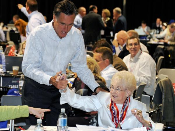 "Former Massachusetts Gov. Mitt Romney greets a volunteer at his ""National Call Day"" fundraising event at the Las Vegas Convention Center on May 16."
